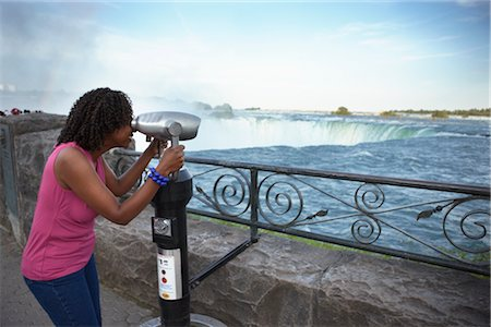 Woman Looking Through Viewer at Niagara Falls, Ontario, Canada Stock Photo - Rights-Managed, Code: 700-02593655