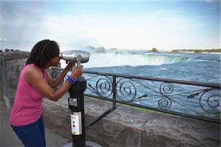 Woman Looking Through Viewer at Niagara Falls, Ontario, Canada Stock Photo - Rights-Managed, Code: 700-02593655