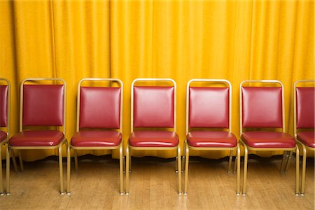 Chairs on Stage with Yellow Curtains Stock Photo - Rights-Managed, Code: 700-02593838