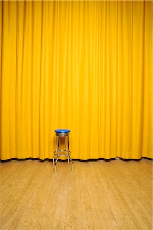 Stool on Stage with Yellow Curtains Stock Photo - Rights-Managed, Code: 700-02593839
