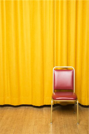 Stool on Stage with Yellow Curtains Stock Photo - Rights-Managed, Code: 700-02593840