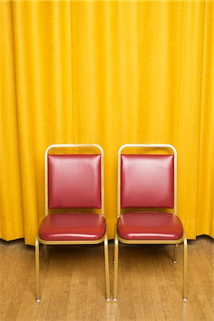 Chairs on Stage with Yellow Curtains Stock Photo - Rights-Managed, Code: 700-02593841