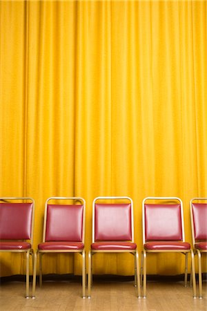 Chairs on Stage with Yellow Curtains Stock Photo - Rights-Managed, Code: 700-02593842
