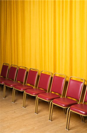 Chairs on Stage with Yellow Curtains Stock Photo - Rights-Managed, Code: 700-02593843