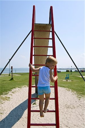Little Boy Climbing Slide on Playground at the Beach, Germany Stock Photo - Rights-Managed, Code: 700-02637279