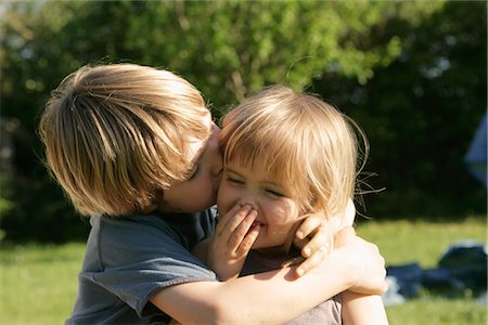 Little Boy Kissing His Sister on the Cheek, Normandy, France Stock Photo - Rights-Managed, Code: 700-02637822