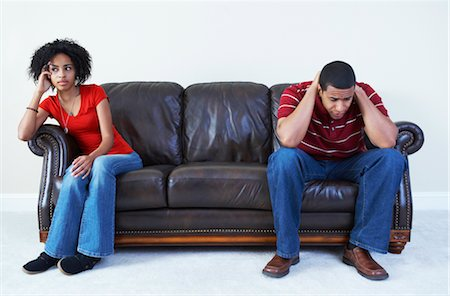 Couple Ignoring Each Other on Sofa Stock Photo - Rights-Managed, Code: 700-02637901