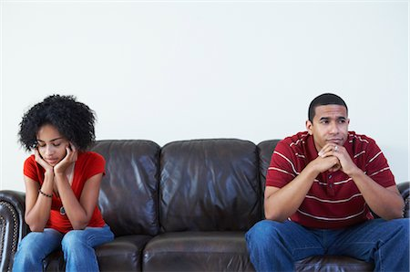 Couple Ignoring Each Other on Sofa Stock Photo - Rights-Managed, Code: 700-02637902
