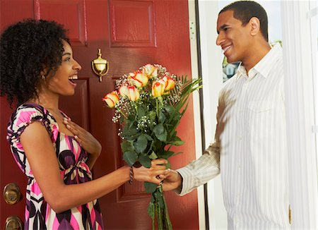 Woman Receiving Flowers from Man in Doorway Stock Photo - Rights-Managed, Code: 700-02637914
