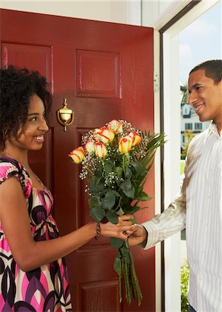 flower greeting - Woman Receiving Flowers from Man in Doorway Stock Photo - Rights-Managed, Code: 700-02637915