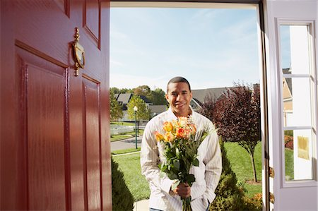 flower greeting - Man in Doorway with Flowers Stock Photo - Rights-Managed, Code: 700-02637911