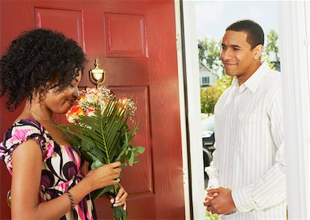 flower greeting - Woman Receiving Flowers from Man in Doorway Stock Photo - Rights-Managed, Code: 700-02637912