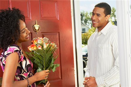 flower greeting - Woman Receiving Flowers from Man in Doorway Stock Photo - Rights-Managed, Code: 700-02637913