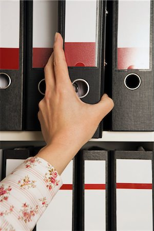 Businesswoman Reaching for File Folder Stock Photo - Rights-Managed, Code: 700-02638192
