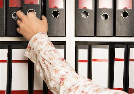 Businesswoman Reaching for File Folder Stock Photo - Rights-Managed, Code: 700-02638193