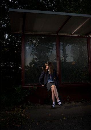 Girl Waiting at Bus Stop at Night Stock Photo - Rights-Managed, Code: 700-02633615