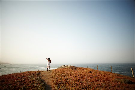 Woman Looking over Ocean, Pacific Coast Highway, California, USA Stock Photo - Rights-Managed, Code: 700-02649075