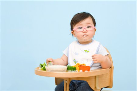 Baby Eating in Highchair Stock Photo - Rights-Managed, Code: 700-02669894