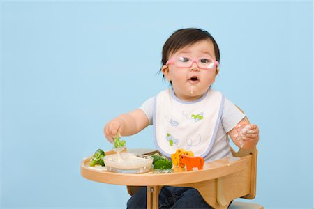 Baby Eating in Highchair Stock Photo - Rights-Managed, Code: 700-02669895