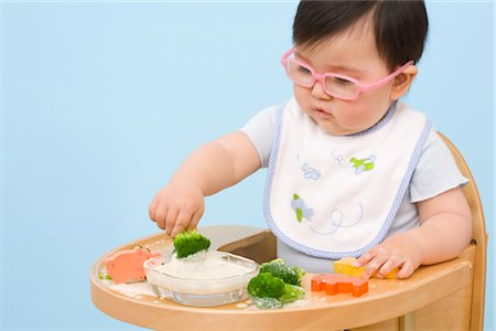 Baby Eating in Highchair Stock Photo - Rights-Managed, Code: 700-02669896