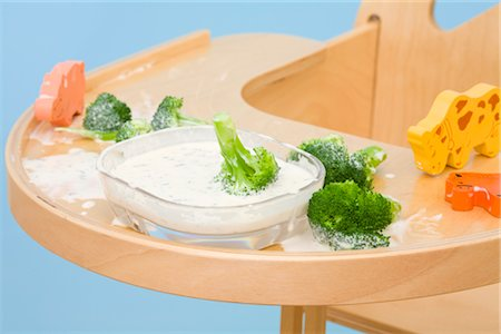 Broccoli and Dip on Highchair Tray Stock Photo - Rights-Managed, Code: 700-02669897