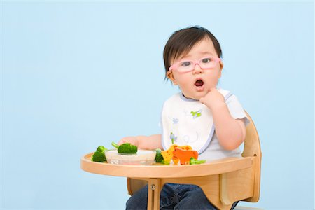 Baby Eating in Highchair Stock Photo - Rights-Managed, Code: 700-02669892