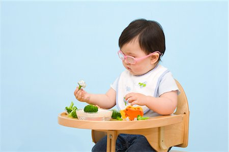 Baby Eating in Highchair Stock Photo - Rights-Managed, Code: 700-02669893