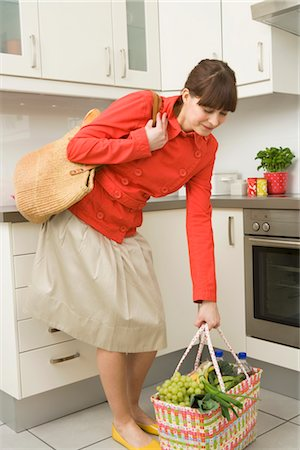 Woman in Kitchen with Shopping Bags Stock Photo - Rights-Managed, Code: 700-02670018