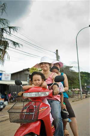 Family Riding a Motorbike in Siem Reap, Cambodia Stock Photo - Rights-Managed, Code: 700-02670067