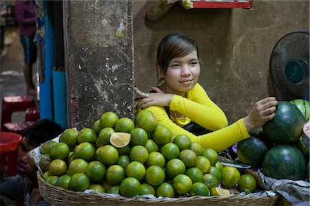 Woman Selling Green Tangerines at Market, Siem Reap, Cambodia Stock Photo - Rights-Managed, Code: 700-02670081