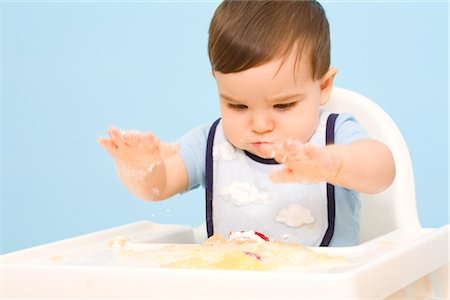 Baby Eating in High Chair Stock Photo - Rights-Managed, Code: 700-02670494