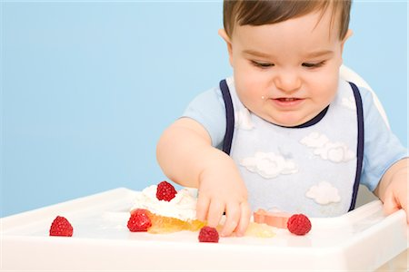 Baby Eating in High Chair Stock Photo - Rights-Managed, Code: 700-02670490