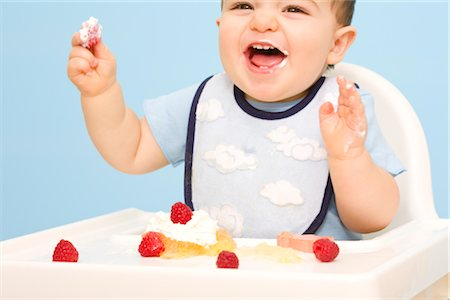 Baby Eating in High Chair Stock Photo - Rights-Managed, Code: 700-02670492