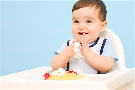 Baby Eating in High Chair Stock Photo - Rights-Managed, Code: 700-02670493