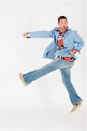 Man Jumping and Doing a Kick Stock Photo - Rights-Managed, Code: 700-02670644