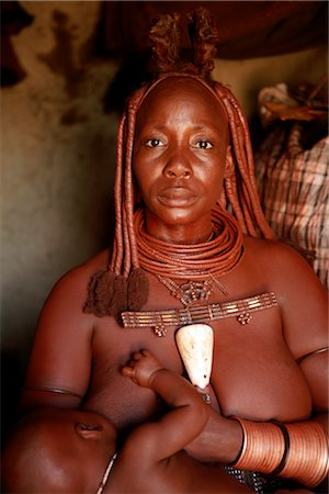Portrait of Himba Woman Breastfeeding Baby, Opuwo, Namibia Stock Photo - Rights-Managed, Code: 700-02694003
