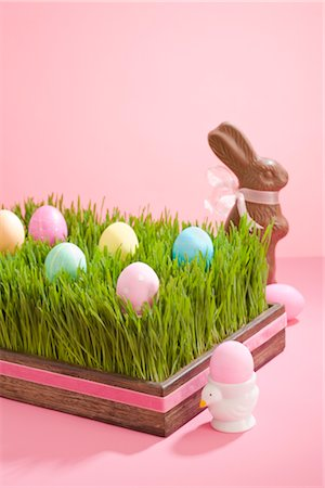 Easter Eggs in Tray Filled with Grass and Chocolate Easter Bunny Stock Photo - Rights-Managed, Code: 700-02694066