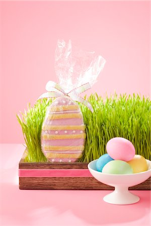 Easter Cookie in Grass Filled Tray with Dish of Dyed Easter Eggs Stock Photo - Rights-Managed, Code: 700-02694063