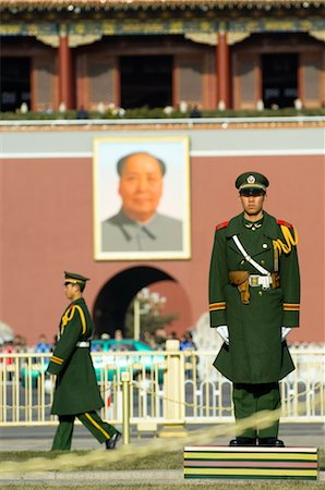 Paramilitary Policeman on Guard at the Gate of Heavenly Peace, Portrait of Mao Tse-tung in the Background, Imperial Palace, Tiananmen Square, Forbidden City, Beijing, China Stock Photo - Rights-Managed, Code: 700-02698372