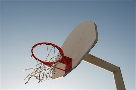 Basketball Hoop With Torn Netting Stock Photo - Rights-Managed, Code: 700-02698437