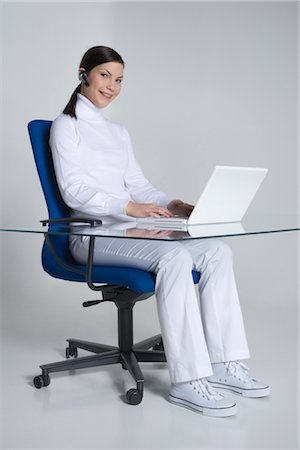 Woman Sitting at Desk using Laptop Computer Stock Photo - Rights-Managed, Code: 700-02693761