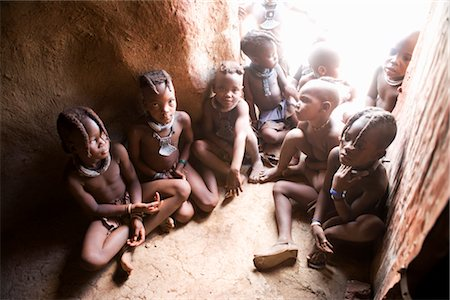 Himba Children Sitting on Floor of Hut, Namibia Stock Photo - Rights-Managed, Code: 700-02693942