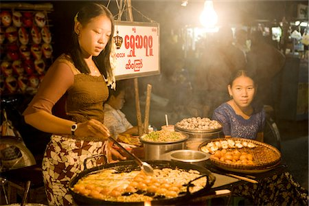 Woman Cooking Food at Stand, Mandalay, Myanmar Stock Photo - Rights-Managed, Code: 700-02693971