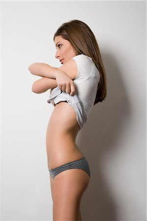 Woman Getting Undressed Stock Photo - Rights-Managed, Code: 700-02693987