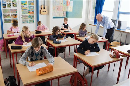 school desk - Students Writing Test in Classroom Stock Photo - Rights-Managed, Code: 700-02702611