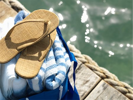Towels and Shoes on a Dock by the Ocean, Belize Stock Photo - Rights-Managed, Code: 700-02702708