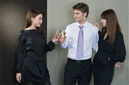 Man as Part of a Couple, Flirting With Another Woman Stock Photo - Rights-Managed, Code: 700-02702770