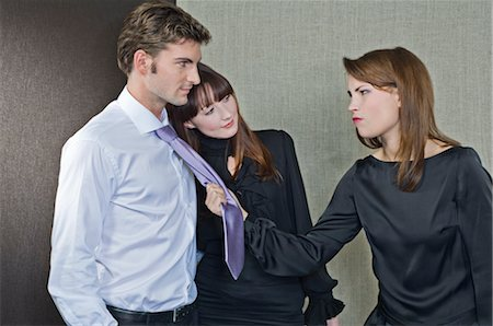 Woman Trying to Grab Man Away From Another Woman Stock Photo - Rights-Managed, Code: 700-02702772