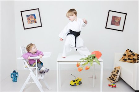 Boy on Table in Karate Pose Stock Photo - Rights-Managed, Code: 700-02724694