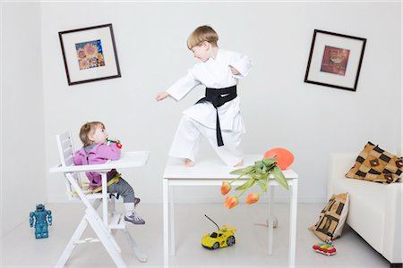 Boy on Table in Karate Pose Stock Photo - Rights-Managed, Code: 700-02724695